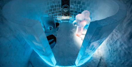 art suite with pink ice sculpture with blue walls made of snow and ice