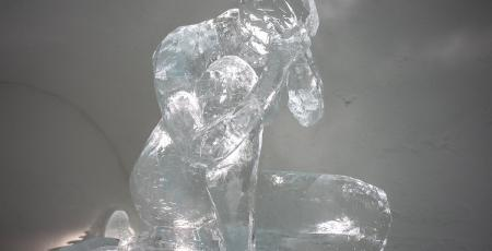ice sculpture of a sitting woman in Icehotel