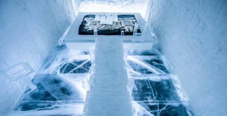 dock on water leading to the bed in art suite made of snow and ice