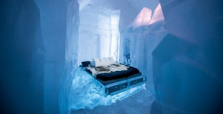 art suite with double bed inside Icehotel