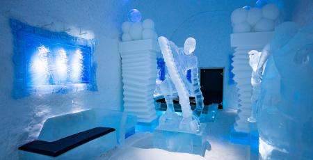 bedroom with ice art sculptures inside Icehotel