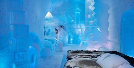 suite filled with toys made of ice and snow at Icehotel