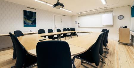 conference room with eight chairs around a table